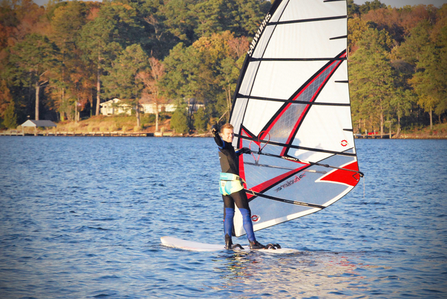 A St. Mary's College student windsurfing on the St. Mary's river on a sunny day.