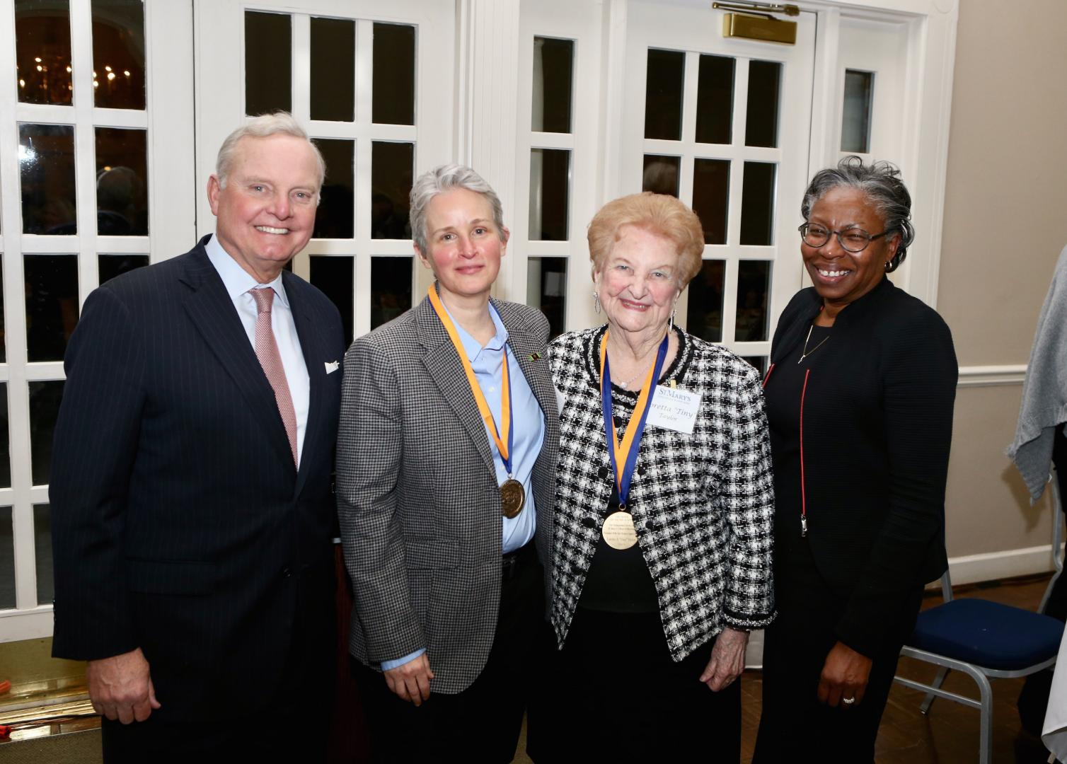"Chairman of the Board of Trustees Sven Holmes, Trish Cole, Loretta ""Tiny"" Taylor, president of St. Mary's College of Maryland Tuajuanda C. Jordan."