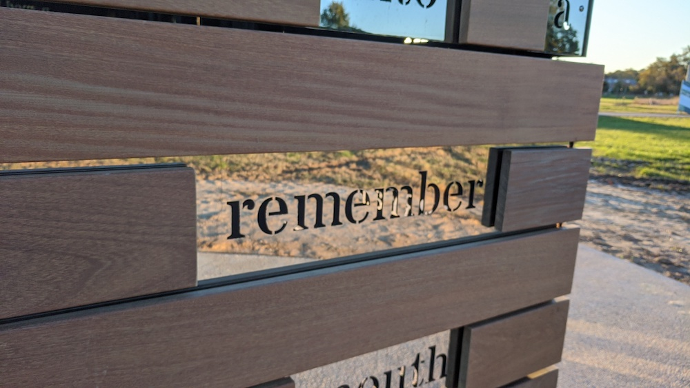 The word Remember edged in glass as part of the Commemorative