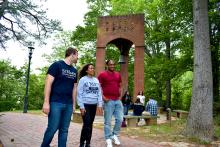 SMCM students walk by the bell tower on campus
