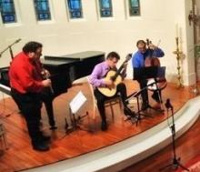 The Clazzical Project after a concert, featuring three male instrumentalists
