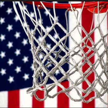a basketball hoop pictured in front of an American flag