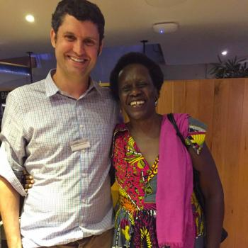 Pictured: George MacLeod with Esther Mujawayo