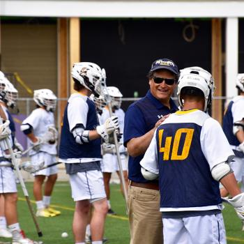 Gary Willis  talking with lacrosse team