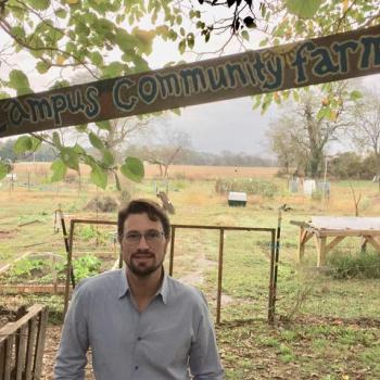 Professor Muchnick at the Kate Chandler Campus Community Farm