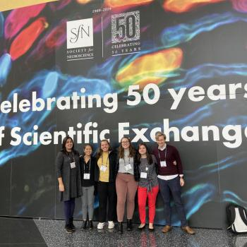 Students gathered in front of Celebrating 50 years of scientific exchange banner