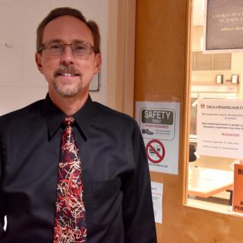 Professor Jeffrey Byrd outside of a teaching laboratory