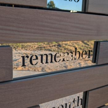 part of the commemorative shown with the word Remember