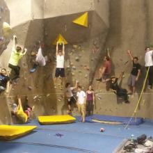 a group of college students on an indoor climbing wall